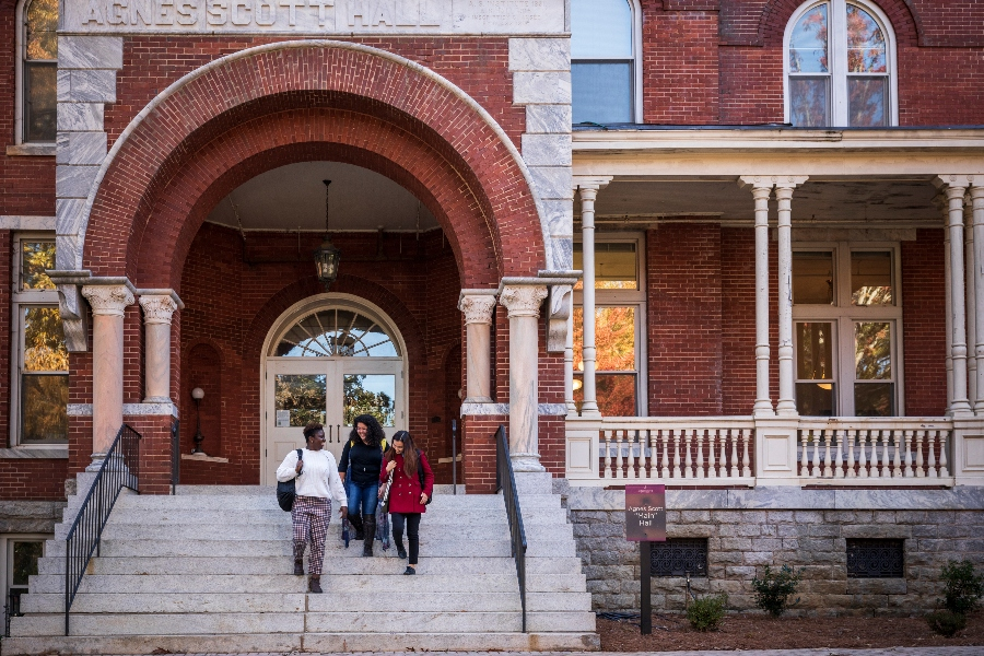 Students walk down the front steps of Agnes Scott's Main Hall