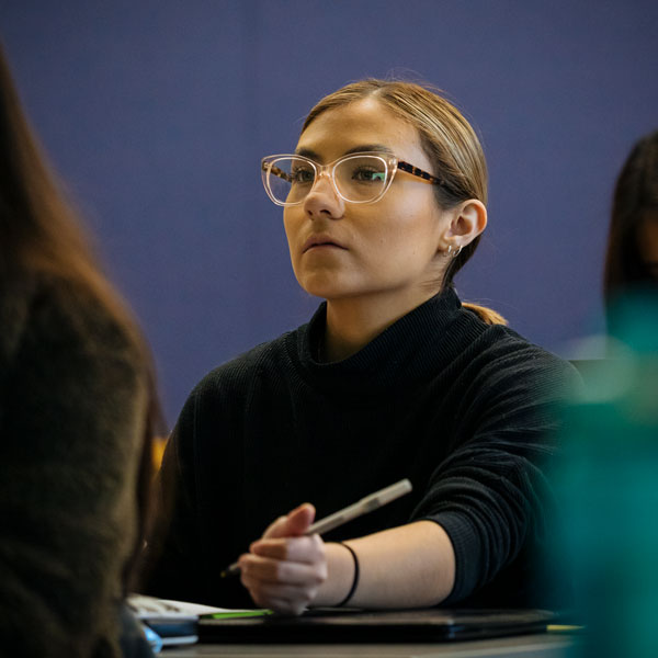 A student listening in class.