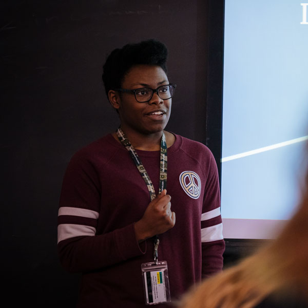 A student gives a presentation to the class.