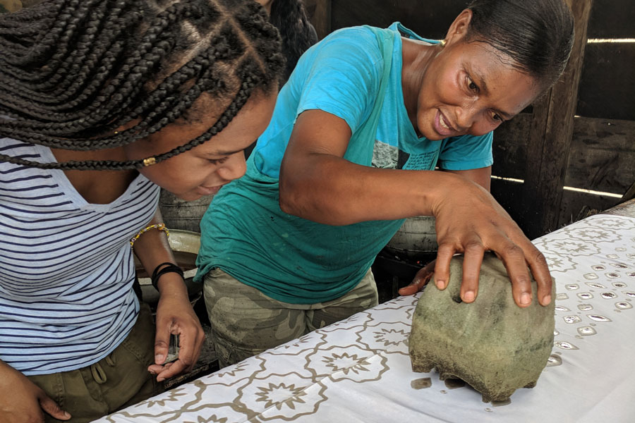 two women making art in Ghana