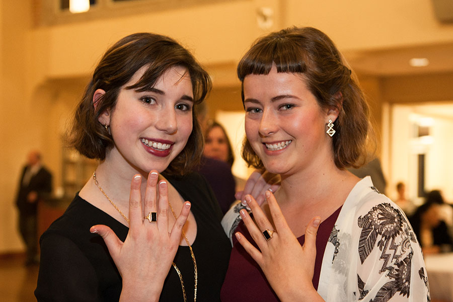 two girls showing their black rings during the Sophomore Ring Ceremony