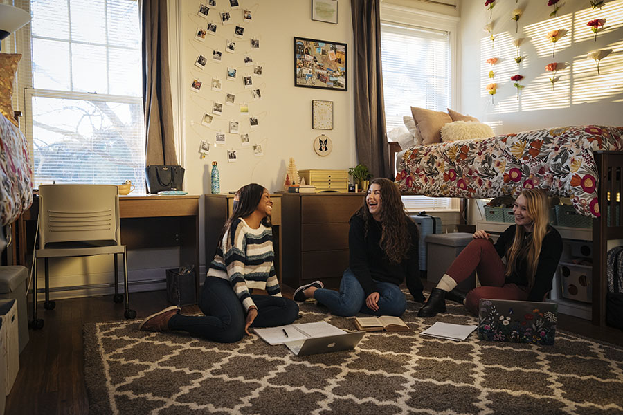 dorm room with three girls talking