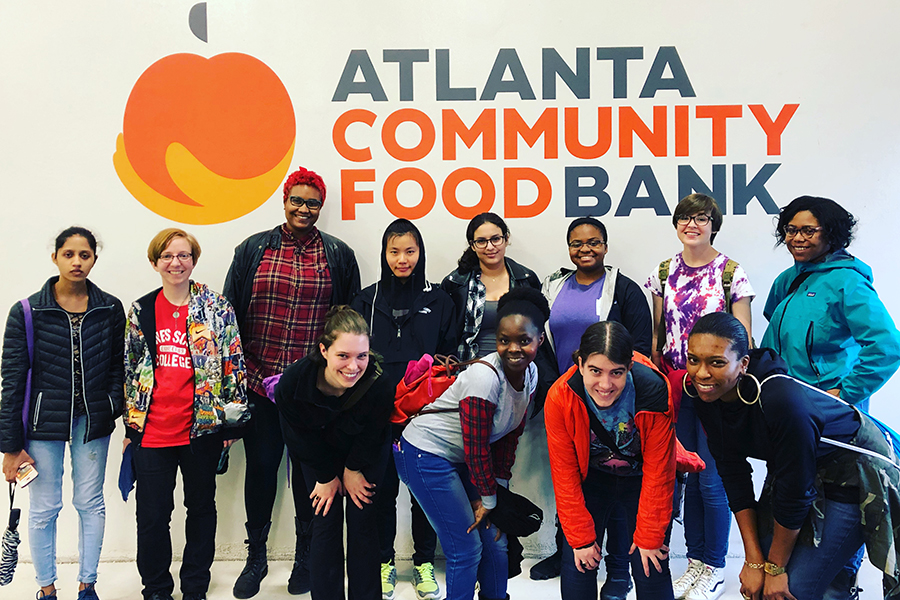 Group of students in front of ATL Food Bank sign