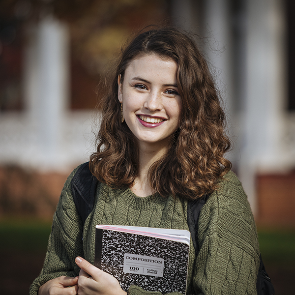 portrait of student holding books