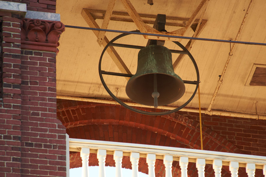 A close up of the bell ringing in the belltower.