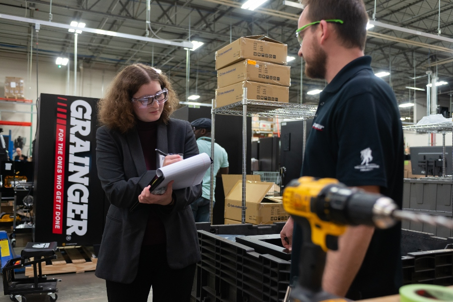 A professional woman and man in a Grainger facility