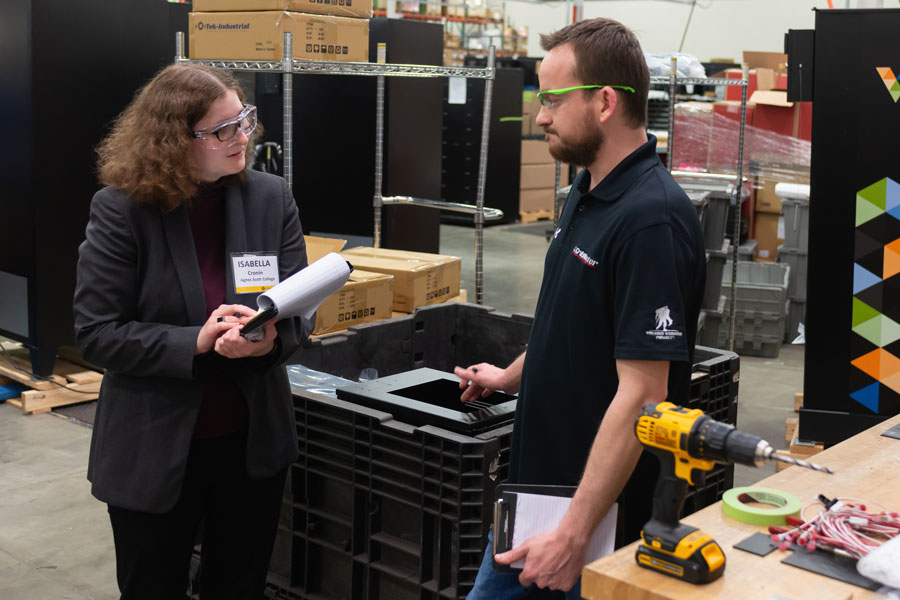 A student conducts an interview during an internship with Black and Decker.