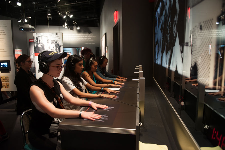 Students participate in an activity at the Center for Civil and Human Rights as a part of Legacy.